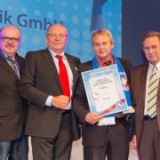 Ing. Günter Vida auf der Bühne mit Auszeichnung bei der Wahl beliebtester Installateur Wien Meidling